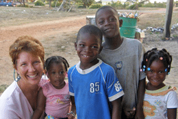 Annie with village children